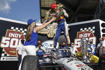 BorgWarner's Michelle Collins (left) and 2020 Indianapolis 500 winner, Takuma Sato (right)