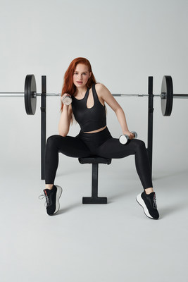 Madelaine Petsch wearing the Callie Medium Impact Sports Bra & High-Waisted Iridescent Luxe Leggings from her first Fabletics collection.