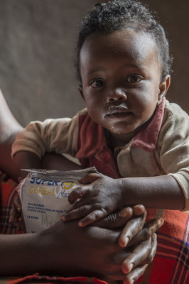 Image of a child eating SuperCereal Plus. Photo courtesy of World Food Programme.